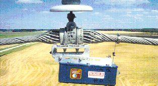 """Регистратор вибраций ALCOA """"SCOLAR III"""", смонтированный на спиральном поддерживающем зажиме"""