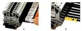 Современные способы маркировки электрических цепей при монтаже: а - с помощью защелкиваемого держателя; б - с помощью маркировочных колец